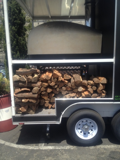 Stack of logs for the brick oven pizza spot, now that's fresh!
